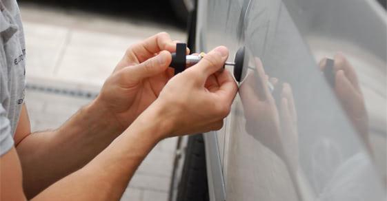 unlocking a car with a lock pick